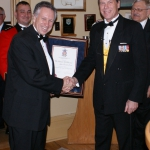 Mr. Rob Baxter receives the Commendation from Col Hutchings for his contributions to the success of the sesquicentennial.