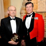 Mr. William James, BMO receives a platinum-level sponsor's shield from Honorary Colonel Mark Hutchings