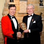 Honorary Colonel Mark Hutchings presents Tim Wilkin, Managing Partner Cunningham Swan Carty Little & Bonham LLP, a platinum-level sponsor's shield