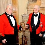 Honorary Lieutenant-Colonel Dr. John Scott Cowan presents Honorary Colonel Emeritus Baron Cyril Woods a platinum-level sponsor's shield