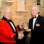 Honorary Lieutenant-Colonel Dr. John Scott Cowan receives a platinum-level sponsor's shield from Brigadier-General (Ret) Ernest B. Beno