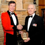 Honorary Colonel M. Hutchings receives a platinum-level sponsor's shield from Brigadier-General (Ret) Ernest B. Benoth a platinum-l;evel sponsor's shield