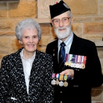 Irene Coghill and Pipe Major CWO (retd) Jack Coghill with the medal